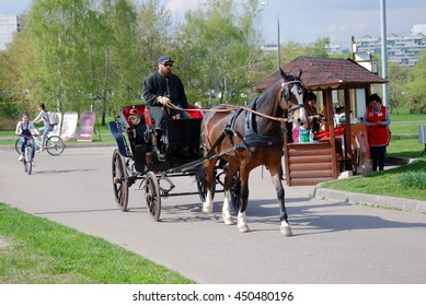 MOSCOW - MAY 03, 2016: Horse carriage in Kolomenskoye park in Moscow, Russia. Popular landmark.