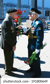MOSCOW - MAY 09, 2014: War veterans speak to each other. Victory Day celebration in Moscow.
