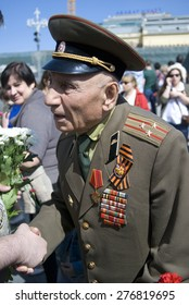 MOSCOW - MAY 09, 2015: War veteran portrait. Victory Day celebration in Moscow.