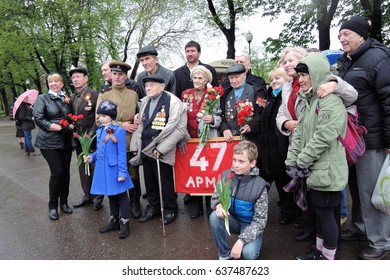 MOSCOW - MAY 09, 2017: War veterans at Victory Day celebration in Moscow, in Gorky park. Color photo.