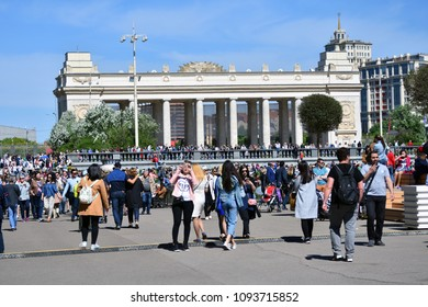 MOSCOW - MAY 09, 2018: View of the main entrance arch of Gorky park in Moscow decorated for Victory day. People walk in the park to join the celebration.