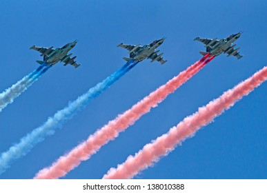 MOSCOW - MAY 09: three Sukhoi Su-25 attack planes fly with smoke trails during during the parade in honor of WWII Victory on May 09, 2013 in Moscow, Russia