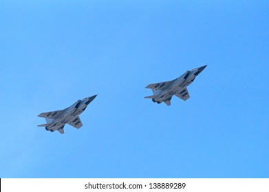 "MOSCOW - MAY 09: two MiG-25 ""Foxbat"" interceptors fly during the parade in honor of WWII Victory on May 09, 2013 in Moscow, Russia"