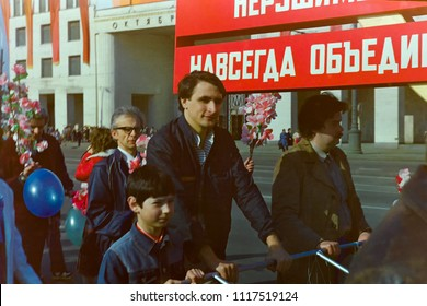 MOSCOW - MAY 1, 1987: Soviet people with banners on trolley move in demonstration devoted to First of May Holiday on May 1, 1987 in Moscow.
