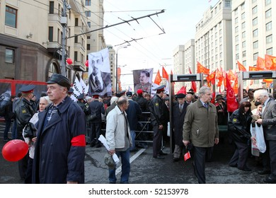 MOSCOW - MAY 1: Communist party supporters take part in a rally marking the May Day, a A portraits of Vladimir Lenin and Josef Stalin seen in the background, May 1, 2010 in Moscow, Russia.