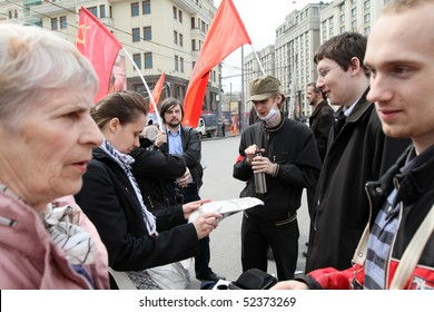 MOSCOW - MAY 1: Communist party supporters take part in a rally marking the May Day, May 1, 2010 in Moscow, Russia.
