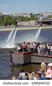MOSCOW – MAY 12, 2018: Wakeboarders perform on the Moscow river at Navigation season-2018 opening in Gorky park, Moscow. Free entrance public event.