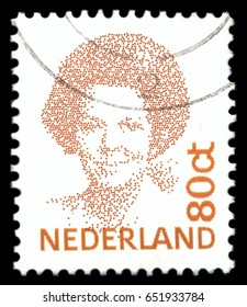 MOSCOW, May 15, 2017: NETHERLANDS - CIRCA 1982: A stamp printed in Netherlands shows portrait of Queen Beatrix regnant of the Kingdom of the Netherlands, circa 1982