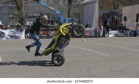 MOSCOW - MAY 15, 2018: Stunt rider making wheelie while rides on the rear wheel on May 15, 2018 in Moscow, Russia