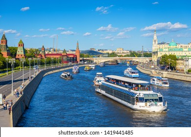 Moscow – May 19, 2019: Panorama of Moskva River and Kremlin Embankment in Moscow, Russia. Cityscape of Moscow with tourist boats and ships. Romantic water trip across the Moscow city center in summer.