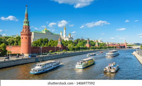 Moscow – May 19, 2019: Tourist ships sail past to Moscow Kremlin, Russia. Famous old Moscow Kremlin is a top landmark of the city. Panorama of the Moscow center with Moskva River in summer.