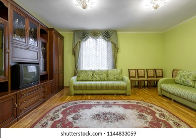 Moscow - May 2, 2018: Interior of hotel or home in Soviet style. Living room with vintage furniture and old TV. Contemporary flat interior with retro decoration.