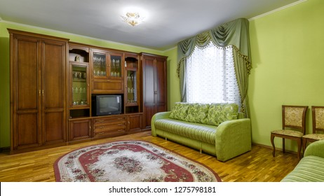 Moscow - May 2, 2018: Interior of hotel or home in Soviet style. Panorama of living room with vintage furniture and old TV. Contemporary flat interior with retro decoration.