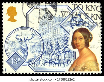 MOSCOW, may 21, 2020:  A stamp printed by GREAT BRITAIN shows portrait of Queen Victoria against Crystal Palace, Monarch of the Glen and Grace Darling, circa September 1987