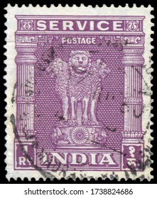 MOSCOW, may 21, 2020:  A stamp printed in India shows four Indian lions capital of Ashoka Pillar, without inscription, from the series Ashoka Pillar, circa 1957