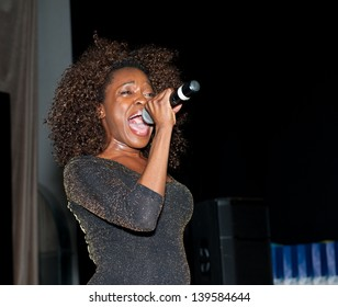 """MOSCOW - MAY 22: Singer Karmen Moxie performs at graduation """"Colours of Life"""" in MOD gallery on May 22, 2013 in Moscow."""