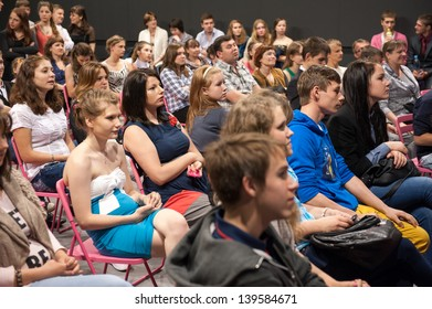 "MOSCOW - MAY 22: Unidentified people listen to speech at graduation ""Colours of Life"" in MOD gallery on May 22, 2013 in Moscow."