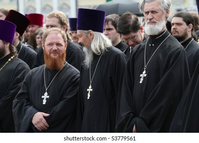MOSCOW - MAY 24: Orthodox clergymen walk near the Kremlin, while celebrating the Holiday of St. Cyril and Methodius, the creators of Cyrillic alphabet, May 24, 2010 in Moscow, Russia.