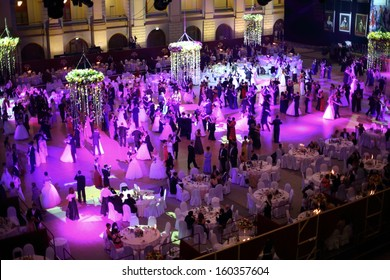 MOSCOW - MAY 25: Hall with tables and beautiful people under purple lights at 11th Viennese Ball in Gostiny Dvor on May 25, 2013 in Moscow, Russia.