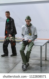 Moscow - May 26, 2018: Boy playing with drone at the international exhibition of  the helicopter industry, HeliRussia. Public-event.