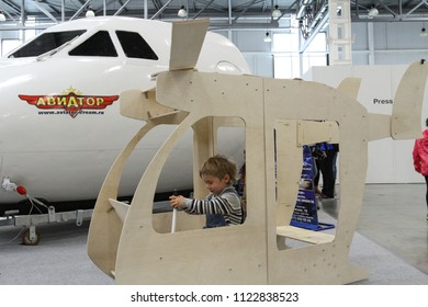 Moscow - May 26, 2018: Child in a toy helicopter at the international exhibition of  the helicopter industry, HeliRussia. Public-event.