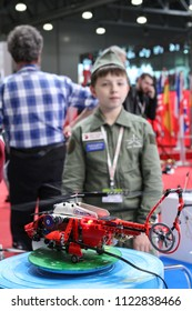 Moscow - May 26, 2018: Kid with helicopter, focus on the helicopter at the international exhibition of  the helicopter industry, HeliRussia. Public-event.