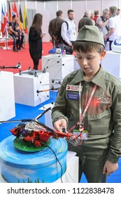 Moscow - May 26, 2018: Kid with RC helicopter at the international exhibition of  the helicopter industry, HeliRussia. Public-event.