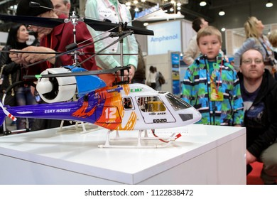 Moscow - May 26, 2018: Man, kid and RC helicopter, focus on the helicopter at the international exhibition of  the helicopter industry, HeliRussia. Public-event.