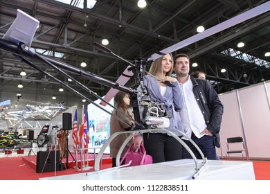 Moscow - May 26, 2018: Man and woman with RC helicopter at the international exhibition of  the helicopter industry, HeliRussia. Public-event.