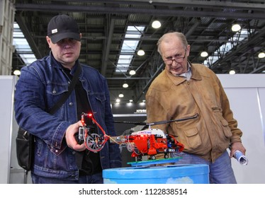 Moscow - May 26, 2018: Mans with RC helicopter at the international exhibition of  the helicopter industry, HeliRussia. Public-event.
