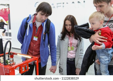 Moscow - May 26, 2018: People are watching the work of a 3D printer at the international exhibition of  the helicopter industry, HeliRussia. Public-event.