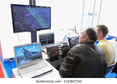 Moscow - May 26, 2018: Training on the flight simulator at the international exhibition of  the helicopter industry, HeliRussia. Public-event.