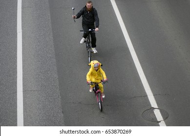 MOSCOW - MAY 28, 2017: Many people ride bicycles in Moscow city center. Parade of bicyclists on Sadovoye koltso (Garden Ring), a busy road in Moscow center. They participate in bicyclists' parade.