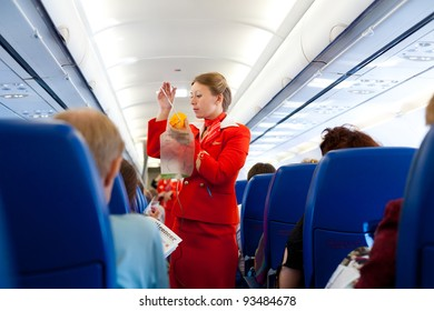"MOSCOW - MAY 28: Unidentified air hostess of ""Aeroflot"" shows how to use an oxygen mask on board, May 28, 2011. ""Aeroflot"", the national carrier, leads in growth rate of passenger traffic in 2011."