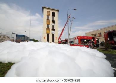 MOSCOW - MAY 29, 2015: Lots of fire-fighting foam goes from hose on fire-station.