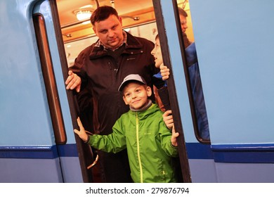 MOSCOW - MAY 5, 2015: People photographed in the doorway of an old subway car at the exhibition of retro-cars dedicated to the 80th anniversary of the Moscow Metro. Public-event