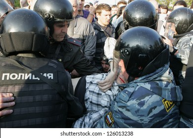 MOSCOW - MAY 6: Injured person is carried away by police during the demonstration against newly elected president Vladimir Putin on May 6, 2012 in Moscow, Russia.