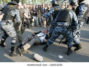 MOSCOW - MAY 6: Police attack journalists during the demonstration against newly elected president Vladimir Putin on May 6, 2012 in Moscow, Russia.