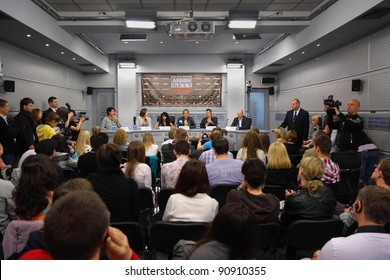 MOSCOW - MAY 6: Popular Dutch DJ Armin Van Buuren (center) and English musician Christian Burns (to his left) speak at a press conference on May 6, 2011 in Moscow, Russia.