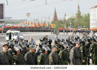 MOSCOW - MAY 6: Russian troops stand guard opposite Kremlin at the start of the rally against newly elected president Vladimir Putin May 6, 2012 in Moscow, Russia.