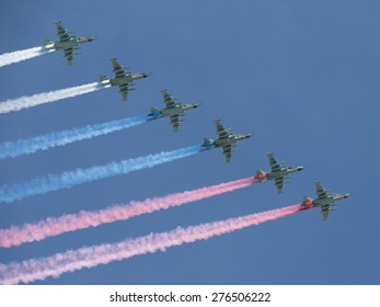 Moscow - May 7th, 2015: six powerful aircraft Su-25 produced a beautiful smoke three colors of the Russian flag at Victory Parade against the bright blue sky May 7, 2015, Moscow, Russia