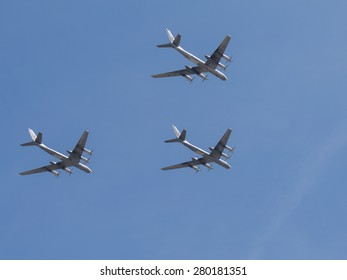 Moscow - May 7th, 2015, three Tu-95MC aircraft formation flying against a blue sky with clouds May 7, 2015, Moscow, Russia