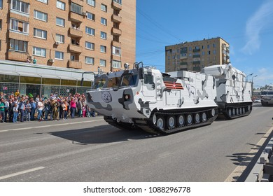 MOSCOW, MAY, 9, 2018: Great Victory holiday parade of Russian military vehicles tank: anti-aircraft weapon system TOR M2DT Arctic on DT 30PM. Double platform off road tank. People in the background.