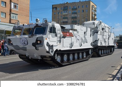 MOSCOW, MAY, 9, 2018: Great Victory holiday parade of Russian military vehicles tank: anti-aircraft weapon system TOR M2DT Arctic. Double platform off road tank. People in the background.