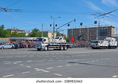 MOSCOW, MAY, 9, 2018: Great Victory holiday parade of Russian military vehicles: cabin snowmobile TTM-1901-40 Berkut 2 arctic. Celebrating people in the background. New modern russian weapon
