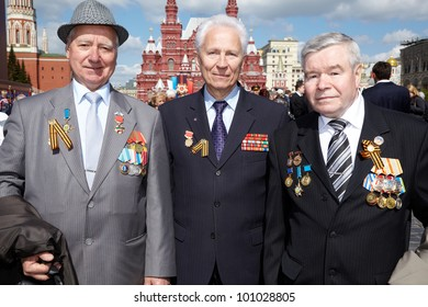 MOSCOW - MAY 9: Veterans of Labor B.Panteleevich, V.Leontievich, S. Fiodorovich on Victory Day celebration on Red Square, May 9, 2011, Moscow, Russia. Veterans are awarded with labour decorations.