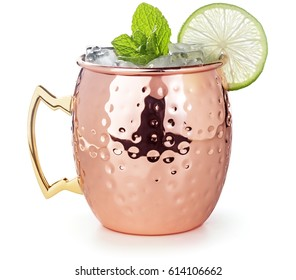 moscow mule cocktail in a copper mug garnished with lime and mint leaves