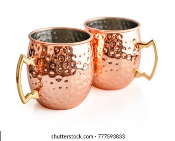 Moscow mule cocktail copper mugs isolated on white background