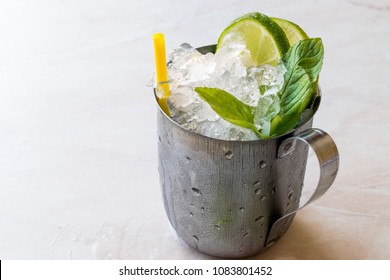Moscow Mule Cocktail with Lime, Mint Leaves and Crushed Ice in Metal Cup.