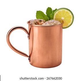 Moscow Mule in a Copper Mug. This is a Vodka drink served with mint, and a garnished with a slice of lime, The image is a cut out, isolated on a white background, and includes a clipping path.